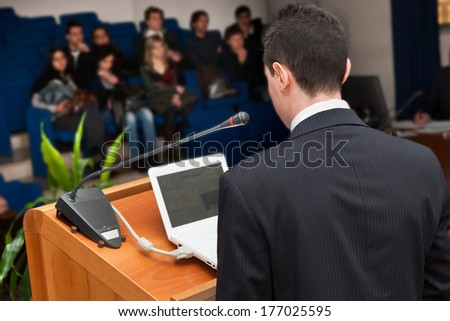Business people group at meeting seminar presentation. - stock photo