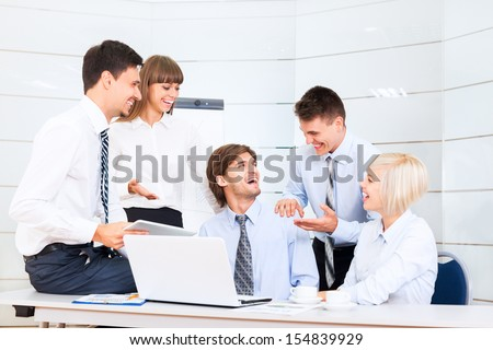 business people group excited happy smile congratulating colleague during meeting, businesspeople sitting at office desk - stock photo
