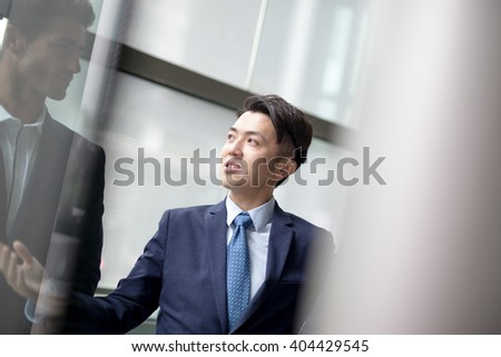 business people group meeting pointing something in front of the office window, asian people,european - stock photo