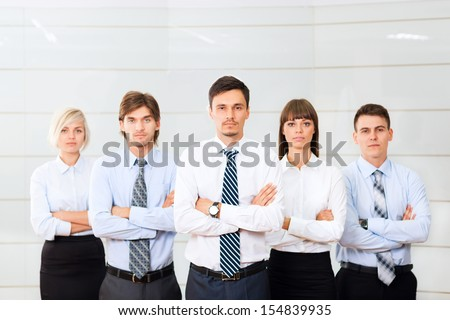 Business people group serious standing line at office, businesspeople row colleague team leader boss folded hands - stock photo