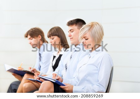 business people group smile sitting row, line in office meeting conference room, businesspeople interview with colleague, human resources