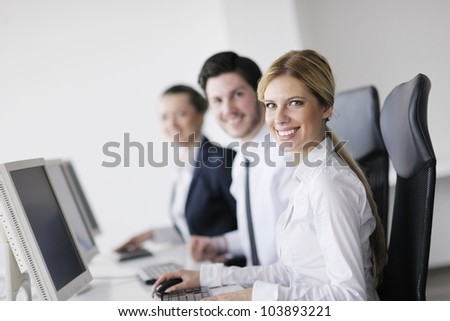 business people group with  headphones giving support in  help desk office to customers, manager giving training and education instructions - stock photo