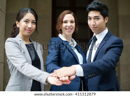 Business people hand joining - stock photo