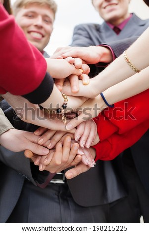 Business people hands together- togetherness concept - stock photo