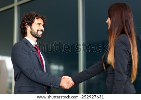 Business people handshake - stock photo
