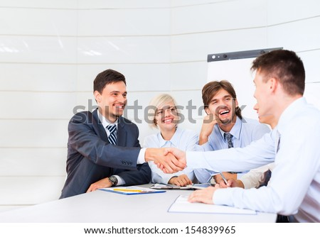 Business people handshake, businessmen smile hand shake, during meeting signing agreement sitting at desk office, corporate team work group on bank conference