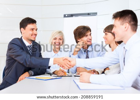Business people handshake, businessmen smile hand shake, during meeting signing agreement sitting at desk office, corporate team work group on bank conference - stock photo