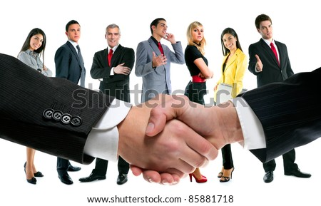 business people handshake with company team in background [Photo Illustration] - stock photo