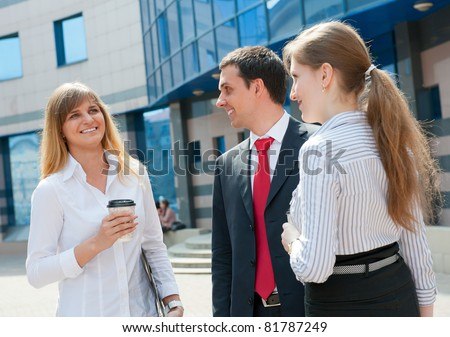 Business people have a coffee break in a modern downtown. - stock photo