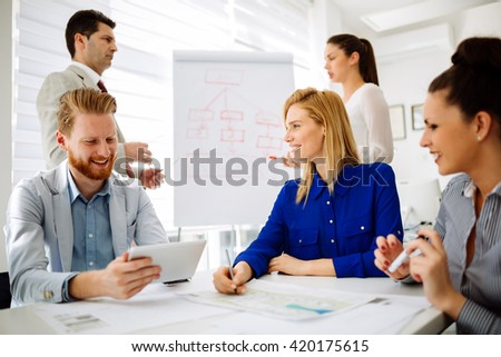 Business people having a board meeting and discussing new fresh ideas