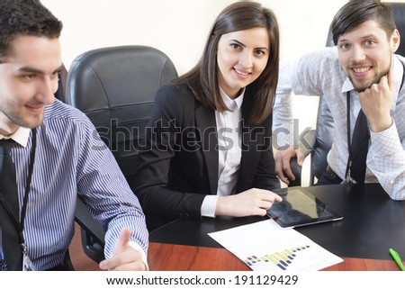 Business people having a board meeting at an office.