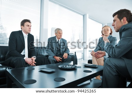 Business people having a break at office meeting - stock photo