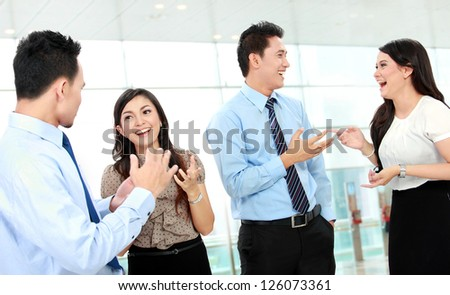 Business people having a conversation in the office