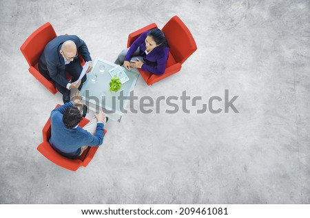 Business People Having a Discussion in an Industrial Building - stock photo