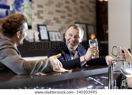 Business people having a drink - stock photo