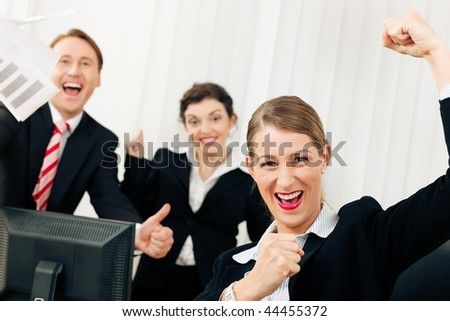 Business people having a lot of fun and letting it show, maybe they are lawyers looking at a favorable ruling, maybe they just got notice of their promotion