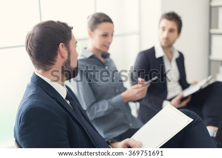 Business people having a meeting and discussing together in the office, brainstorming and teamwork concept - stock photo