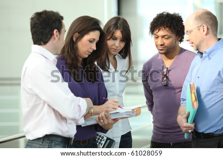 Business people having a meeting in the hall of a company - stock photo