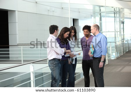 Business people having a meeting in the hall of a company