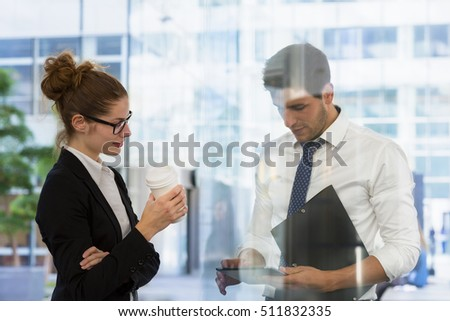 Business people having casual meeting during a coffee break