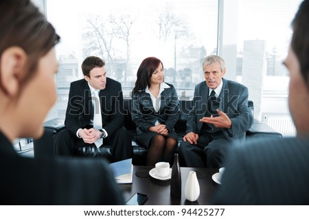 Business people  having coffee at office meeting - stock photo