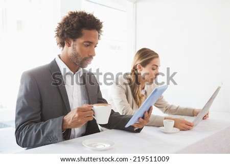 Business people having coffee on their break at the coffee shop - stock photo
