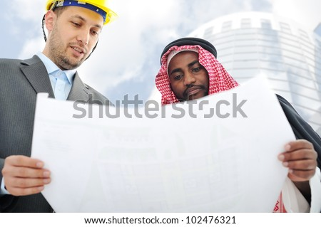 Business people having consulting about new building - stock photo
