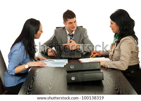 Business people having discussion and business man pointing to laptop screen - stock photo