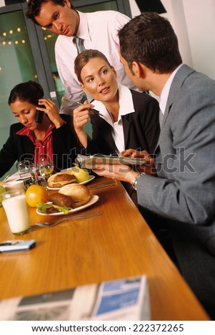 Business people having lunch - stock photo