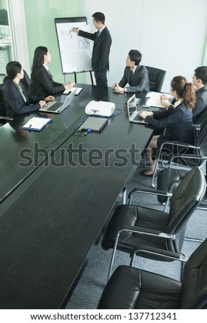 Business people having meeting - stock photo