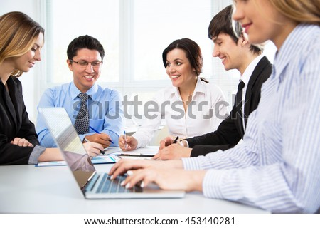 Business people having meeting in modern office - stock photo