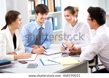 Business people having meeting in modern office