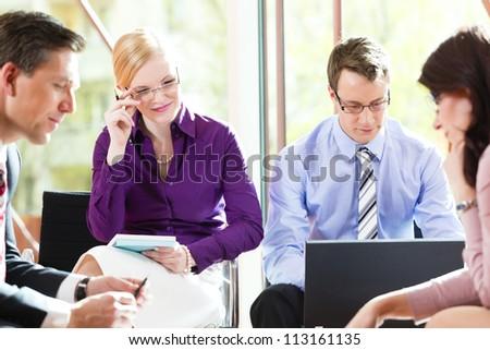 Business people having meeting or workshop in office - stock photo