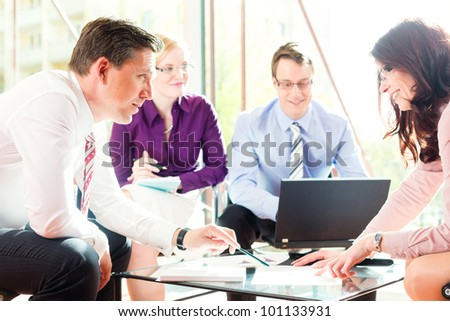 Business people having meeting or workshop in office profit growth graph and documents - stock photo