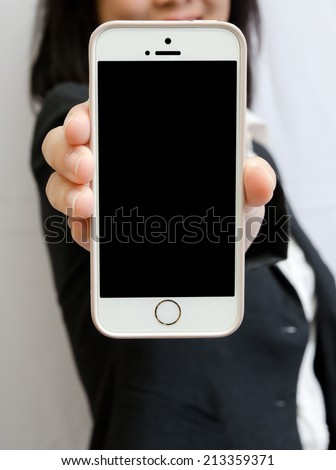 Business people hold smart-phone with black display - stock photo