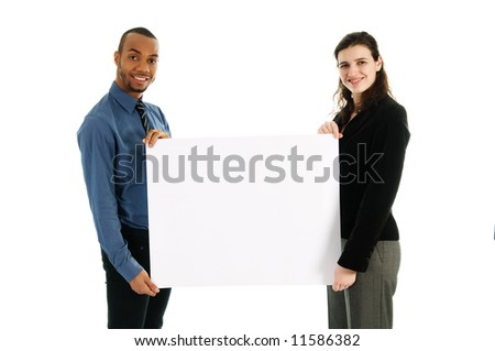 business people holding a white piece of cardboard - stock photo