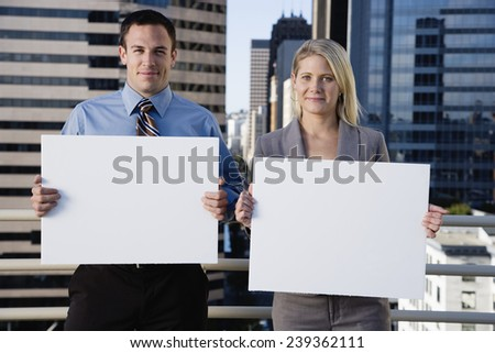 Business People Holding Blank Signs - stock photo