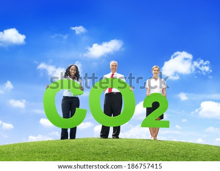 Business People Holding Carbon Dioxide Outdoors - stock photo