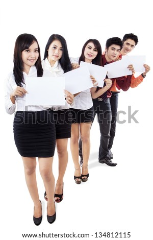 Business people holding copy space sign on white background - stock photo