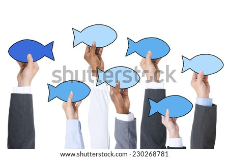 Business People Holding Fish Symbol and Contrasts Concept - stock photo