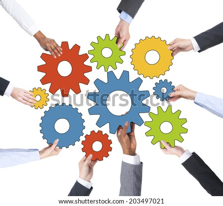 Business People Holding Gears Together - stock photo