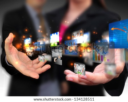 Business people holding social media - stock photo