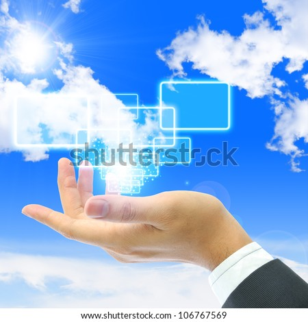Business people holding the button with blue sky background - stock photo