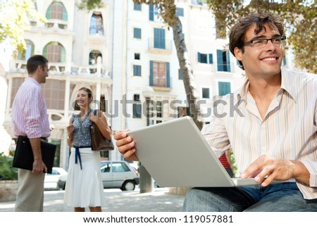 Business people in a city scene, outdoors.