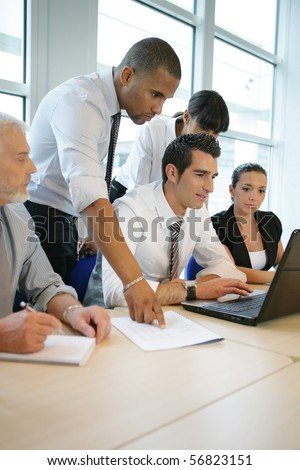 Business people in a meeting with a laptop computer - stock photo