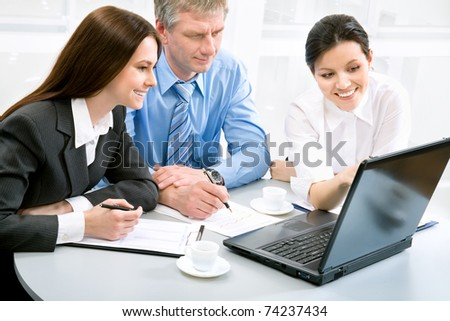 Business people in an office environment - stock photo