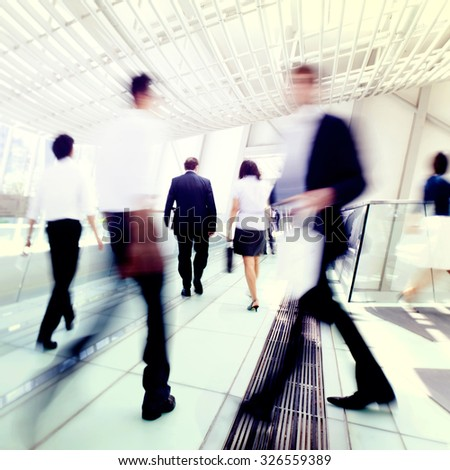 Business people in Asia. Hong Kong. Tilt shift lense with selective focus, Blurred motion. Blue tint. - stock photo