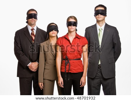 Business people in blindfolds - stock photo