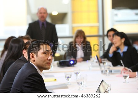 Business people in board room meeting - stock photo