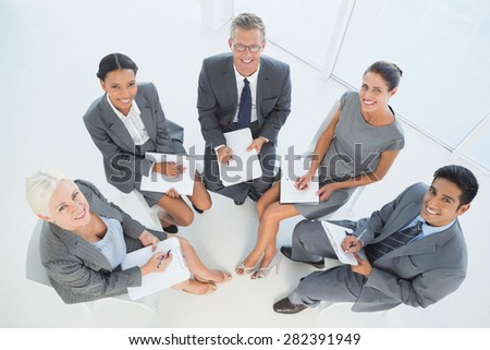 Business people in board room meeting at office - stock photo